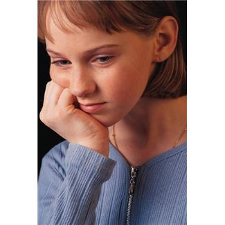 sad young adolescent girl, fist on cheek